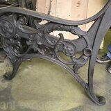 Iron cast side of wooden bench