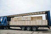 pallet wood board being loaded into full truck load