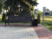 russian wooden park bench with iron cast sides